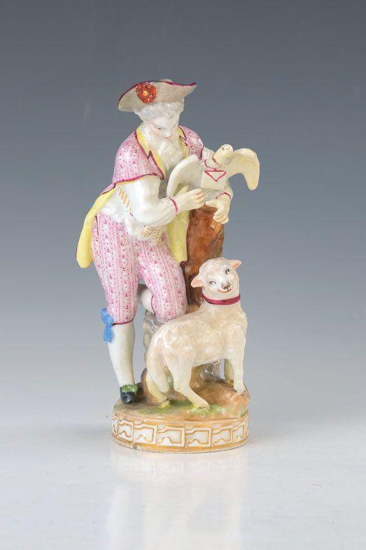 Porzellanfigur, nach Meissner Vorbild, um 1900, Liebesbote mit Schaf, feine bunte Malerei, restauriert, z.T. besch., H. ca. 16 cm  93,- €