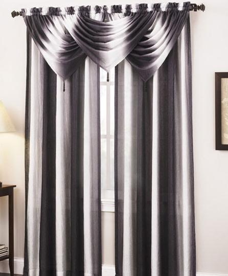 A blend of black and white fabric with an elegant valance makes this room look amazing!!!