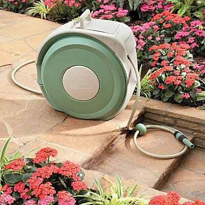 Retractable Hose Reel. Just bought this and hubby mounted on side of house beside my rose bed. Love it. 100' feet of quality hose that retracts fully into the housing with a gentle tug. No more winding that crank!