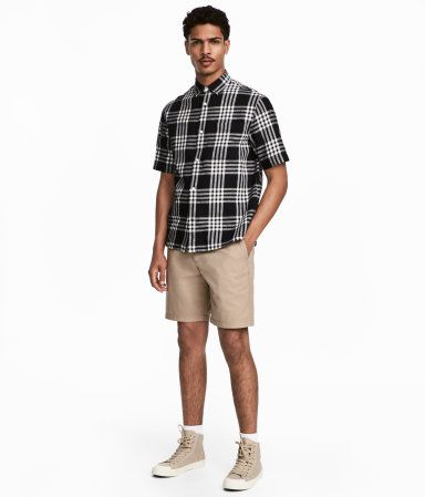 Beige. Chino shorts in washed cotton twill. Zip fly, side pockets, coin pocket, and welt back pockets with button. Regular fit.