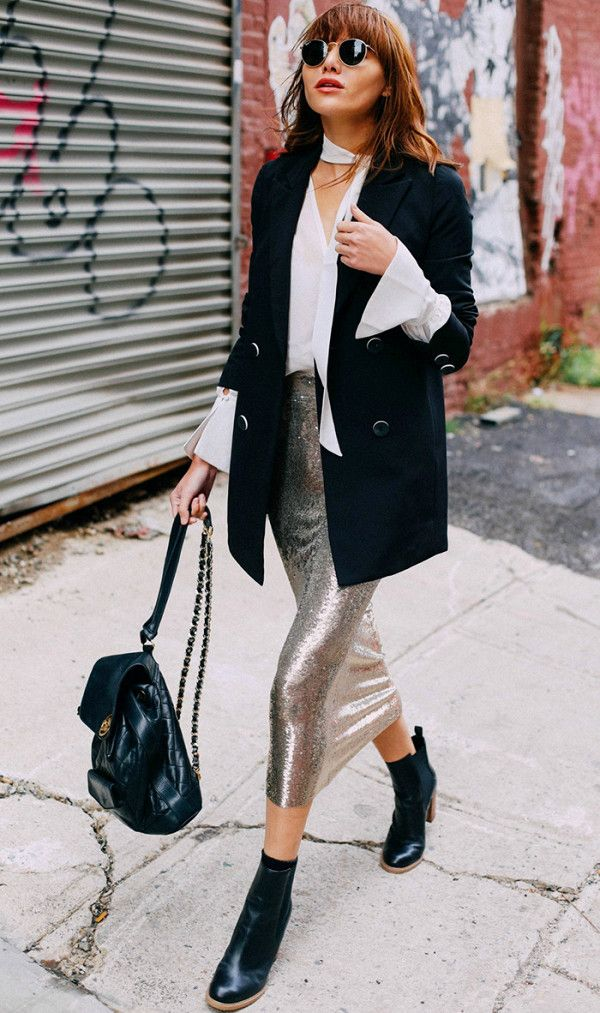 Can't go wrong with a white blouse and black blazer—especially with a little sequin detail