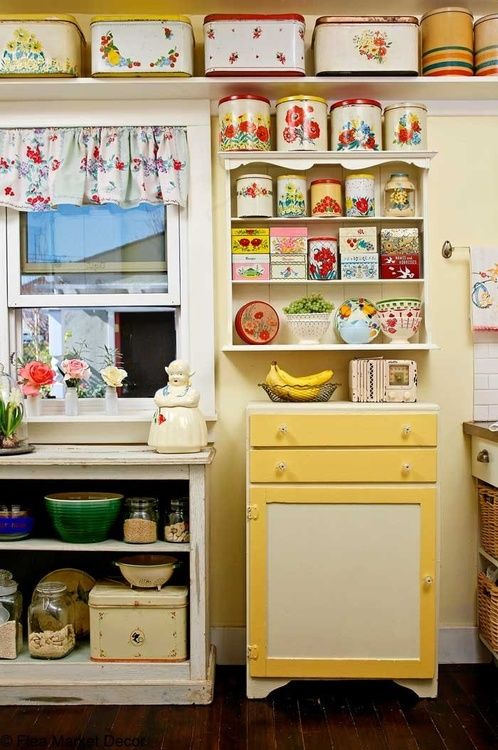 What a darling kitchen! I love the colors and the canisters!: