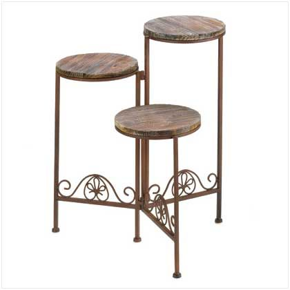 """Weathered wood and rustic finish lend a timeless look to this handsome planter stand! Folding configuration and three graduated pedestals let you arrange your favorite greenery for maximum style impact.Weight 5 lbs. UPC# 817216010439. Folded: 9"""" diameter x 23"""" high; opened: 19 1/2"""" x 15"""" x 23"""" high. Wrought iron and wood."""
