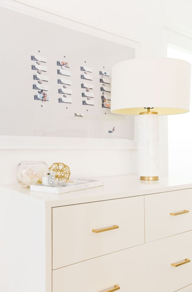 White and gold dresser and lamp