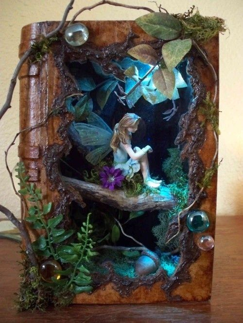 fairy shadow box made from papier mâché book