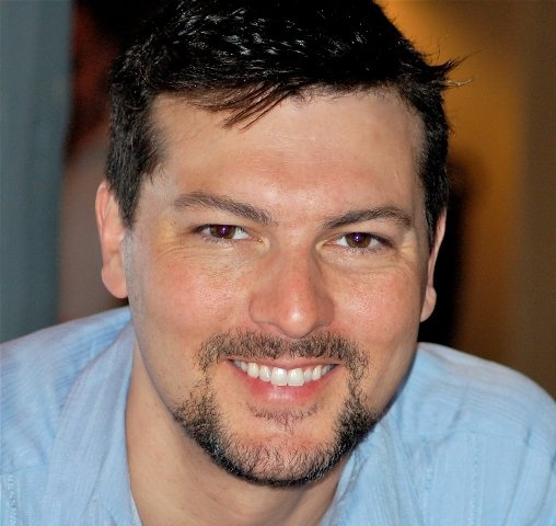 """David Hayter, voice of Snake in Metal Gear Solid. Also the writer of the X-Men and X-Men 2 movies. He's involved in the Kickstarter project """"The Hostage Trials"""" that's running right now - http://www.kickstarter.com/projects/1238523886/the-hostage-trials-a-real-time-game-for-ios-and-an"""