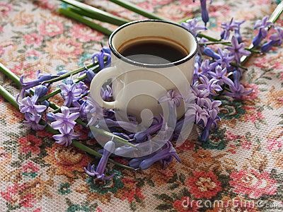 A cup of coffee and hyacinths