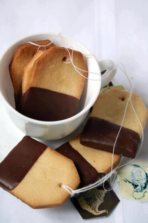 Tea bag cookies - use your favorite rolled sugar cookie recipe, cut into rectangles then slice off the top corners. Punch a hole with a small soda straw before baking. Dip into melted chocolate, add string and your own tag. Cute!