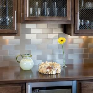 Peel & Stick backsplash tiles... How about I take these tiles and create a headboard and baseboard for my bed. Some wood and crown molding. I think I'm on to something