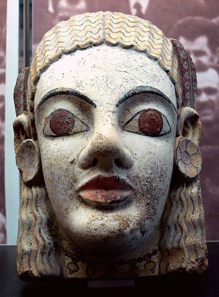 Etruscan terracotta ....compare earrings to similar but larger Mayan earplugs of gold