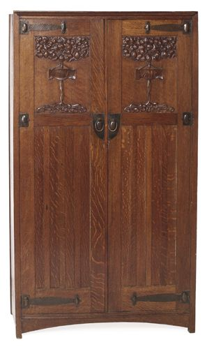 "English Arts and crafts wardrobe; two paneled doors with Tree of Life design and carved motto on each door ""Salve"" and ""Vale""; copper strap hardware"