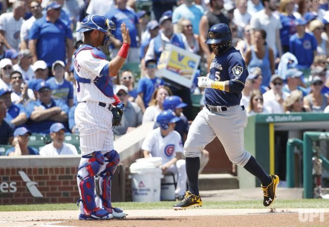 Milwaukee Brewers Jonathan Villar scores on a RBI double hit by .Domingo Santana off Chicago Cubs Mike Montgomery in the first inning at…