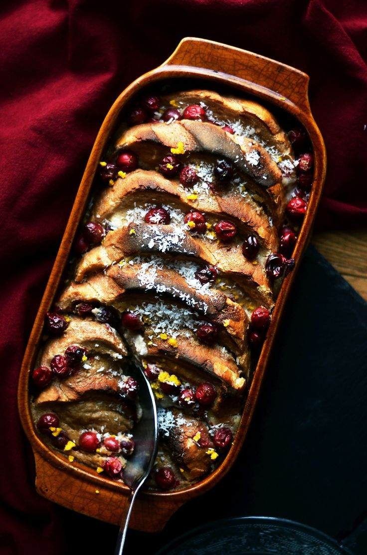 Vegan French toast casserole with festive cranberries. Perfect make ahead breakfast!