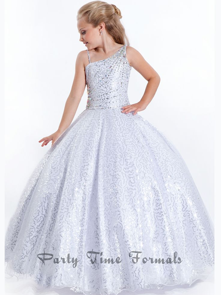 Your stuck on this page just like the judges' eyes will be watching you in this memorizing fully sequin, girls pageant gown. The one shoulder neckline and fully formal gown doesn't event being to describe this glam of this pageant dress. Pair with Jonathan Kayne punkin shoes for a sure win. Features:   Available in sizes 2-14  Colors include White, Coral  Dress Length: Measure Shoulder to Floor For Proper Size  Fabric: Fully Sequin