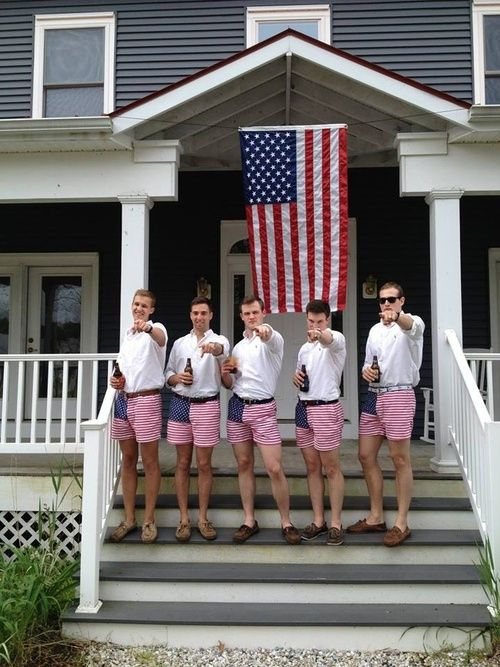 Frat brothers being patriotic while doing what they do best..... drink beer.