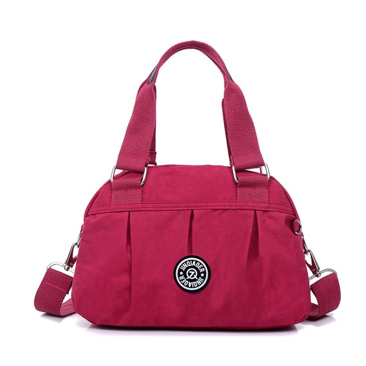 Tiny Chou Pure Color Water Resistant Nylon Satchel Handbag Lightweight Crossbody Messenger Bag. Material: High quality,lightweight waterproof nylon,the gorilla pendant is included.(with Tiny chou logo Cellphone Screen Clean Cloth). Dimension: 11.8 inch(L)*5.5 inch(W)* 7.8 inch(H)£»Handle:7.5. Multiple pockets design,one main zipper compartment can hold books,wallet,purse,umbrella,credit cards,cosmetics and so on;Inner zippered pocket and two small pouches.More convenient and more easy to...