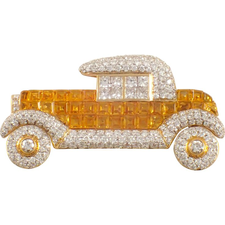 18K YELLOW GOLD YELLOW SAPPHIRE AND DIAMOND CAR BROOCH $7,500 USD