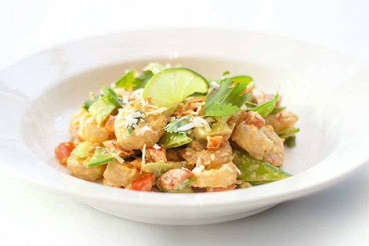 Polynesian Shrimp Salad: snow peas, red bell pepper, green onions, cilantro, and celery, in a zesty sweet pineapple dressing.