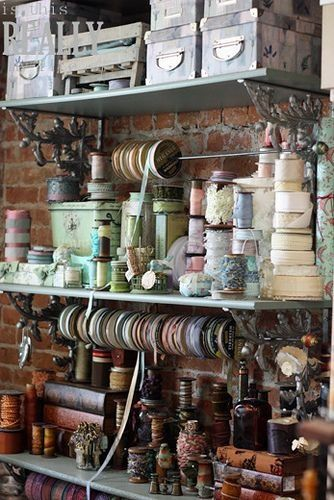 Vintage Craft Room - take note of the brackets used for the shelving - able to use dowel or curtain rod for ribbons etc.