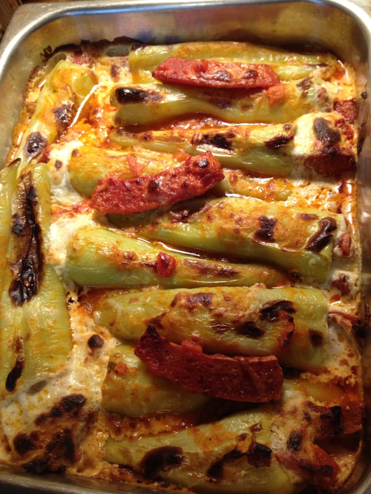 Stuffed Hungarian wax peppers in Vodka sauce with pepperoni, Seasoned cream cheese and Manchego cheese