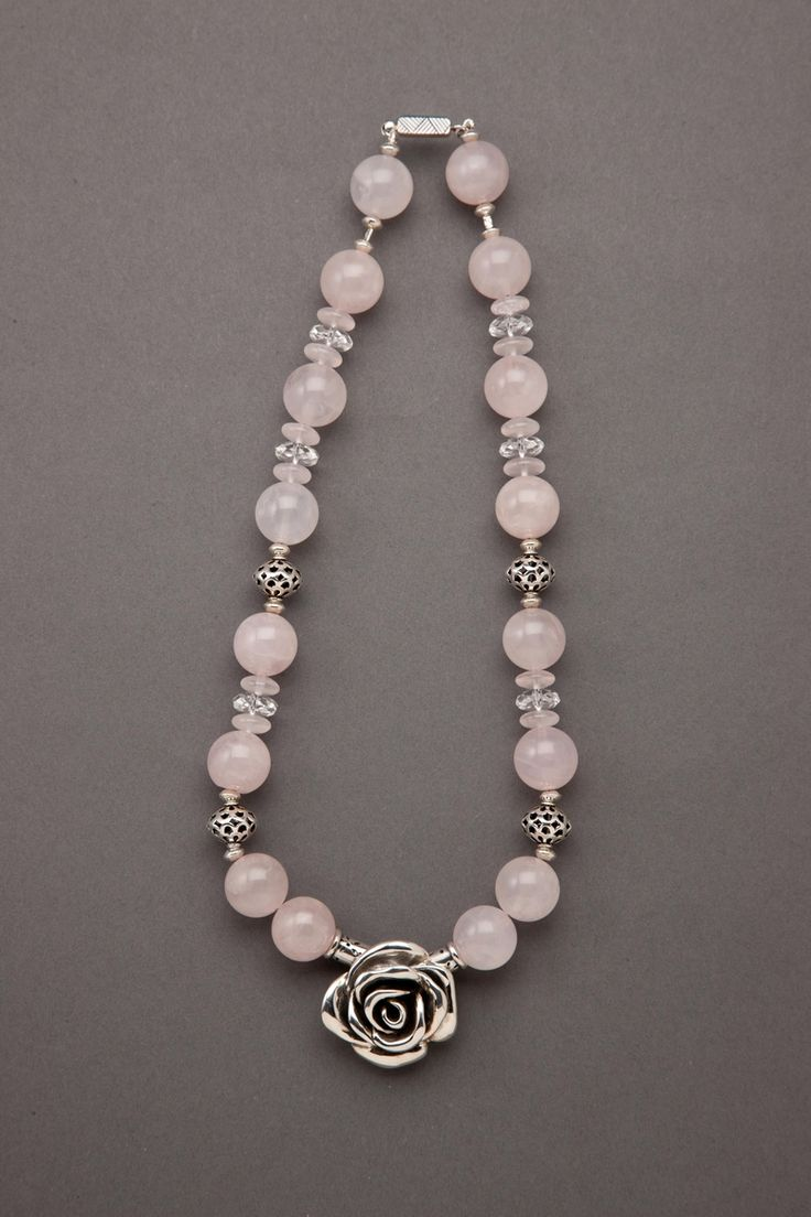 """Love That Rose #Quartz    Sparkle with delight wearing this amazing round and disc shaped translucent Rose Quartz #Necklace mixed with faceted Clear Rock #Crystal Quartz, textured Sterling Silver and featuring a majestic Sterling Silver Rose. Completed with a decorative Sterling Silver Slide Clasp. One-Of-A-Kind. L 20"""" . . . Coordinating Earrings Available"""