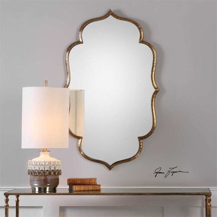 """This Moroccan inspired mirror is hand crafted from hammered iron, finished in a lightly antiqued metallic gold. May be hung horizontal or vertical. - 24 W x 39 H x 1"""" D - Oversized and stately LOW PRI"""