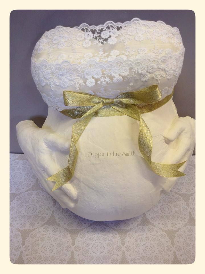 Beautiful cream and white lace with gold ribbon pregnant bump cast with Daddys hands