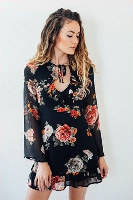 Autumn Bloom Dress: This dress features a ruffled v-neck with tie closure, zip closure at back, and ruffled hemline. Partially lined. Measures 33