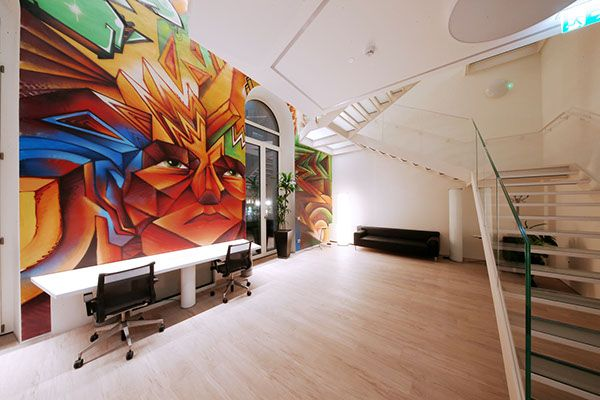 Boston Consulting Group (BCG)'s new headquarters, designed by Albera Monti & Associati Architects, are located in Milan, close to Piazza del Duomo. We were asked to make something outstanding in the offices so we painted some very colorful graff on a 25 meter long wall, from floor to ceiling.