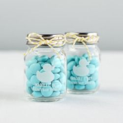 Personalized printed milk jars add a vintage vibe to any baby shower theme.