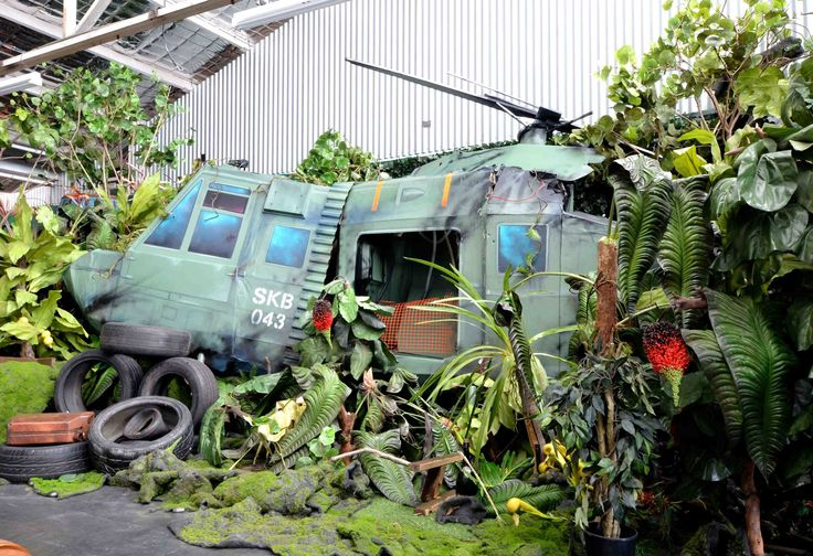 lush jungle with crashed helicopter set one of many in our textural canvas studio in marrickville