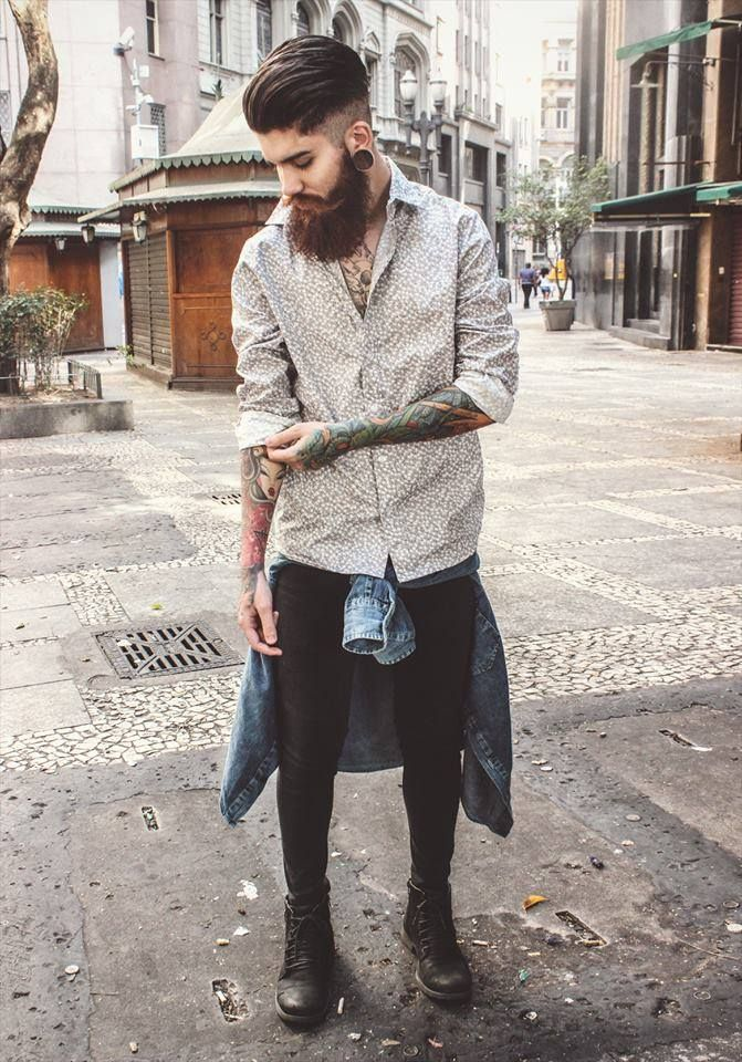Tattoos are a growing trend within the Hipster/Indie subculture. Full and half arm sleeves are a very common sight. Longer beards with shorter combed over hair will typically accompany this look.