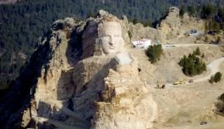The Crazy Horse Memorial is the world's largest mountain carving, planned to be over 650 feet tall. For comparison, the heads of the presidents on Mount Rushmore at 60 feet high.