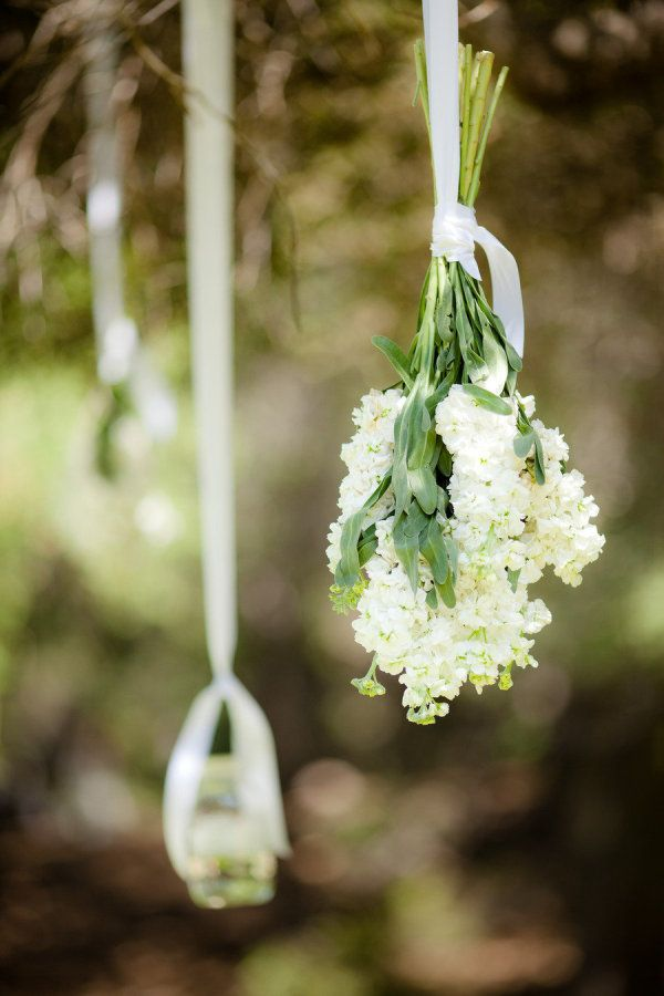 hanging florals at the ceremony site mixed with lanterns ©theyoungrens.com