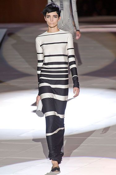 Marc Jacobs Spring 2013  The show in its whole served as an optic play, the lines blurring into each other. Even the accessories went linear. Silhouettes were Mod and spare except for a series of ruffled (see Pierrot) collars and sleeve cuffs.