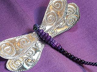 How To Make a Punched Tin Dragonfly From Gingerbread Snowflakes...great on a stake for garden art