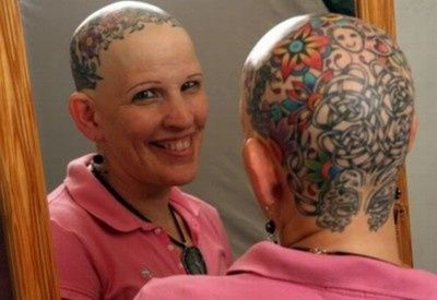From fyeahtattoos.com...    Dotty Jenkins, 48, Effingham, NH   Tattoos done at White Mountain Tattoo in North Conway, NH by Adam Mazza    I lost my hair due to an autoimmune disease called Alopecia Areata so I decided that people are going to stare at a bald woman so I would give them something awesome to stare at and when asked about it I can spread awareness of this life changing disease. mrsgeekgoddess