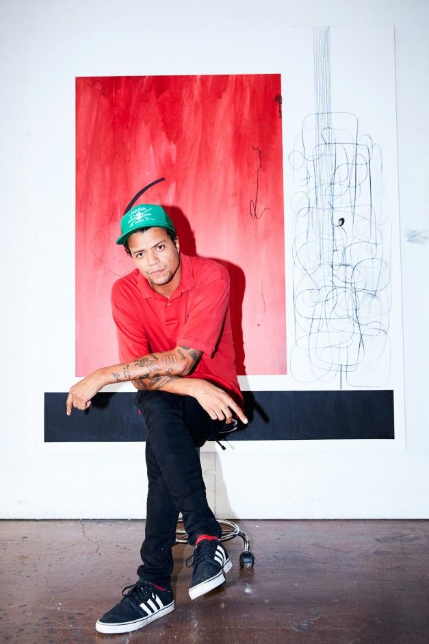 Christian Rosa On Painting for Jay-Z and Leonardo DiCaprio: We talked to Christian Rosa about everything from how he breaks through a creative block to his evolution as an artist, and Jay-Z and Leonardo DiCaprio. -- Red polo shirt and green baseball cap  |  coveteur.com