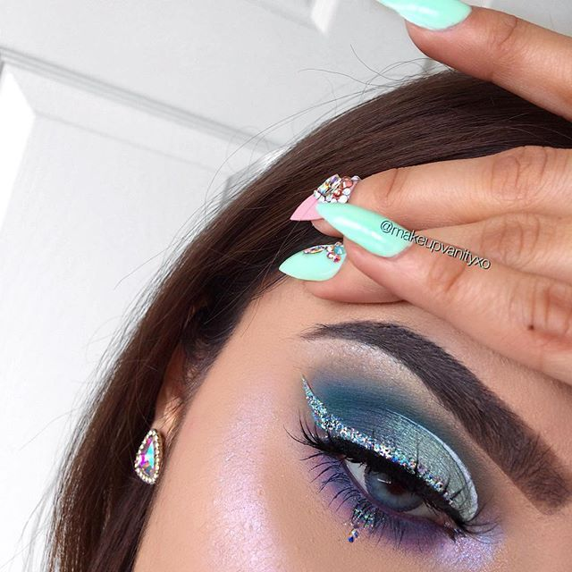 """brows @anastasiabeverlyhills dipbrow pomade in """"ash brown"""" eyes @elfcosmetics primer @nyxcosmetics '""""glass slipper"""" eyeshadow, """"crystal hip"""" glitter liner, & """"white"""" liquid liner @urbandecaycosmetics """"electric"""" palette chunky glitter on lashline is from @jazzy_glitter lashes @clio_beauty """"diva"""" mermaid inspo nails @exhalehatenaildesign highlight @loveluxebeauty """"icing on the c..."""