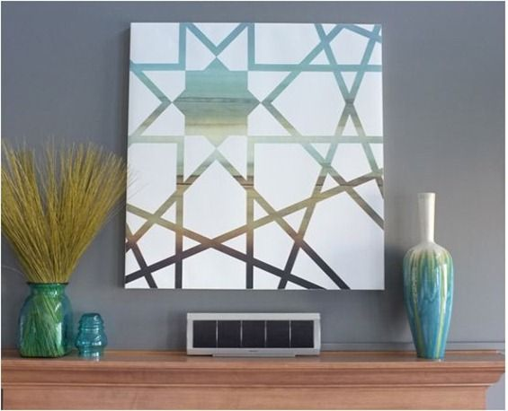 DIY canvas art. This tutorial at teal also has a great tip for ensuring paint doesn't leak under masking tape!