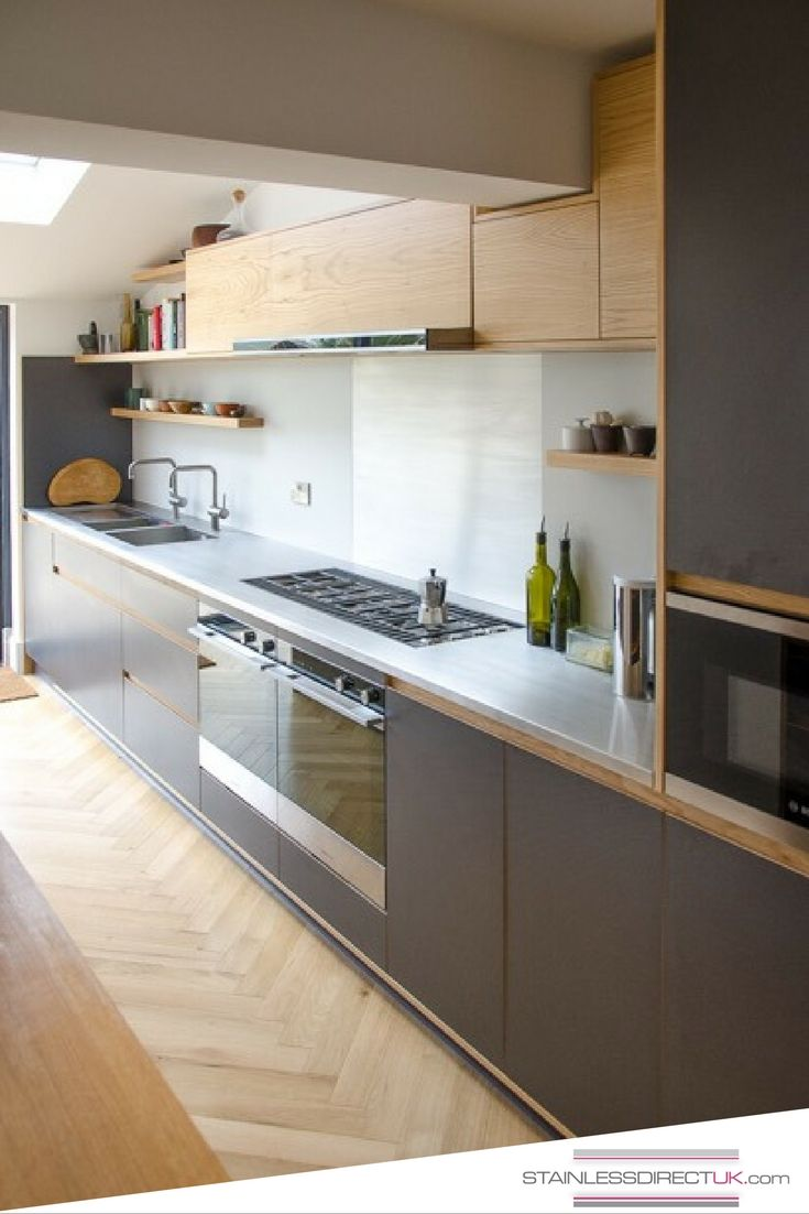 A stainless steel worktop can bring in the little extra sparkle the splashback makes cooking
