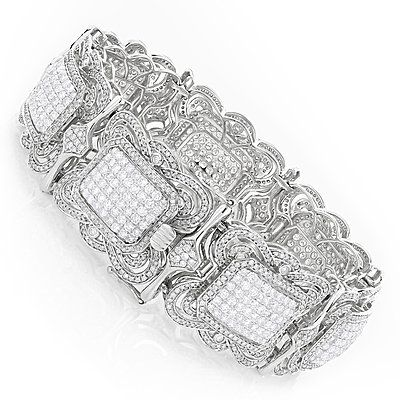 Breathtaking Hip Hop Bracelets: This 14K Gold Mens Diamond Bracelet by Luxurman weight approximately 76 grams and showcase 22.5 carats of pave set sparkling round diamonds. Featuring a unique design only 3 of these men's diamond bracelets were made, only available in white gold.