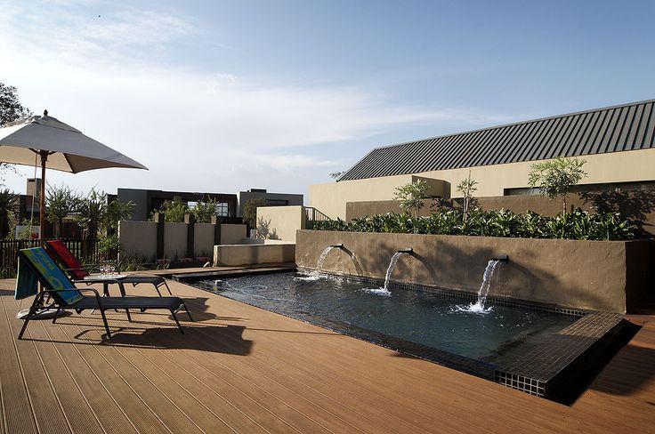 Next to pool, #Eva-tech Merbau looks great. http://www.eva-tech.com/en/