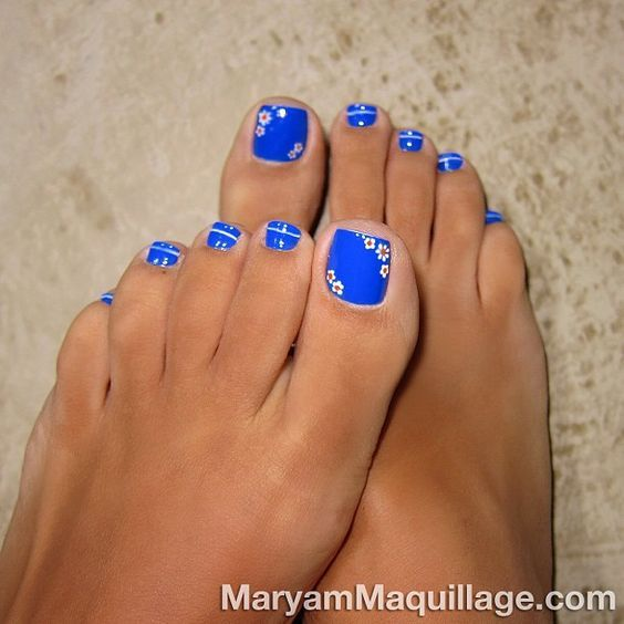 Blue Toe Nails with Flowers via  Some super cute designs here!