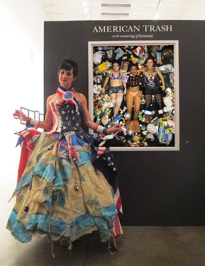 """Sofia wearing """"Old Glory"""" next to Gregg Segal's piece """"7 Days of Garbage"""""""