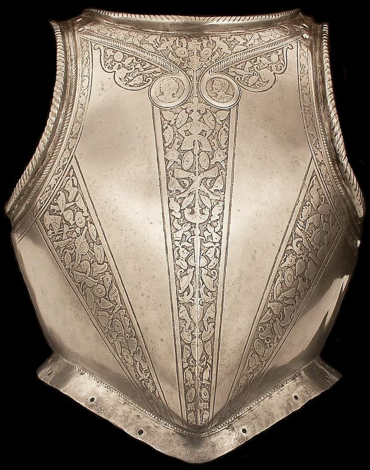 """""""Peascod"""" breastplate for foot service, Northern Italy (Milan), 1575-1600, etched steel, imitating the shape of the contemporary civilian doublet with bands decorated with """"trophies,"""" images representing the spoils of war including both classical and contemporary armor, as well as cannons, shields, swords, and spears. The trophy motif was especially popular in the decoration of late sixteenth-century armor. (Age of Armor) 6 lb. 9 oz. Length 16 1/2"""" L x 14 1/2"""" W x 7"""" D"""