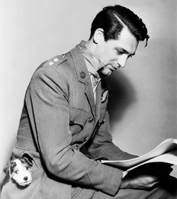 Cary Grant reading a script. With a dog in his pocket.