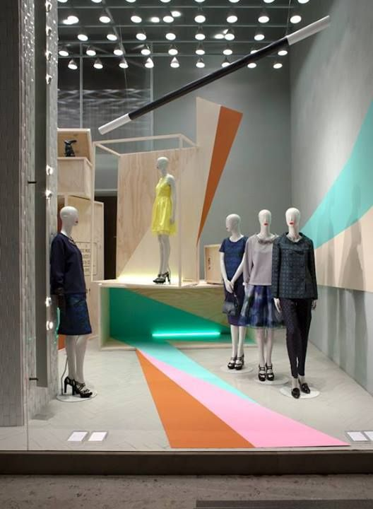 This window display is used simple geometric shapes. To focus merchandising, patterns are used near to mennequins. All the vertex of triangle patterns pointed center, so eyes flow left to the right and center.