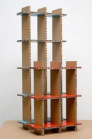 Cardboard used to build a shelf unit.  Repurposed would be best!  All types of great cardboard ideas on this site.  Check it out!