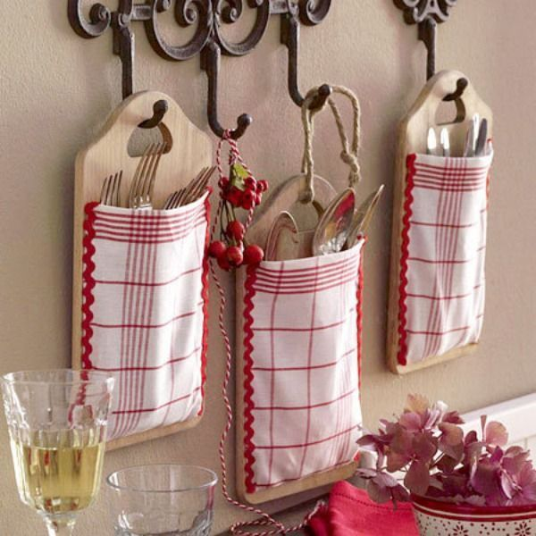 Make cutlery and utensil storage pockets using cutting boards and fabric napkins or hand towels. Great for adding a rustic touch to kitchen decor!